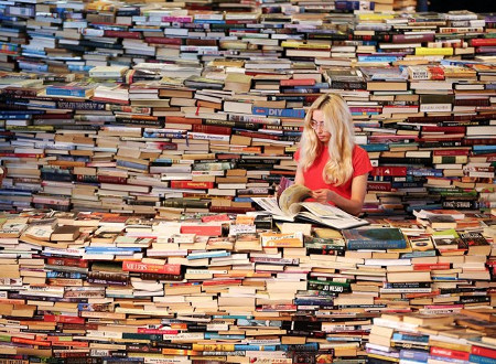 Woman standing in a sea of books