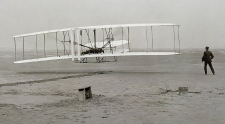 The Wright Flyer making the first powered flight in 1903